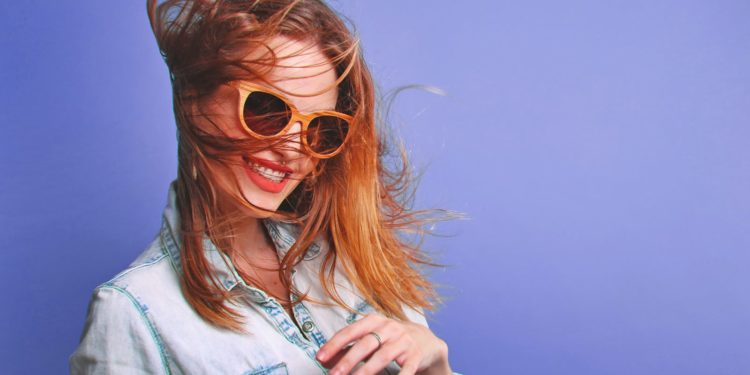 Mysterious Woman Smiling using sunglasses